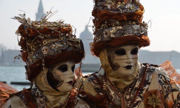 Two masked figures on the Riva degli Schiavoni