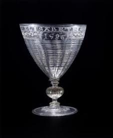 A glass chalice engraved with Elizabeth's name and the date 1586