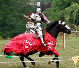 The winner of the joust canters along the lists