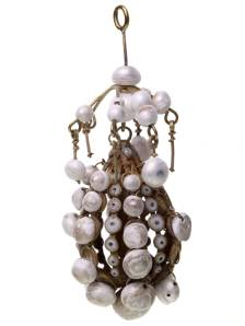 A cage pendant studded with pearls