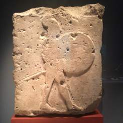 A worn relief showing a Greek hoplite, who would have been a mercenary soldier in the Egyptian army