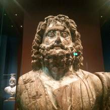 A sycamore wooden statue of the seated Serapis, around life size, from Fayum in Egypt, 2nd century BC
