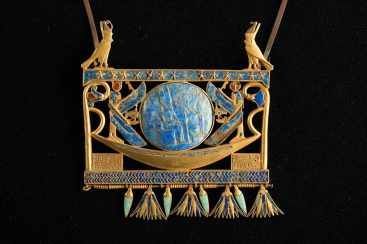 A gold and lapis lazuli pectoral showing the journey of the sun god Amun-Ra in his barge across the sky. c. 930 BC, Egyptian Museum, Cairo