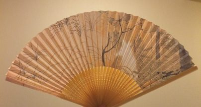 One of my keepsakes from Tokyo National Museum: a fan decorated with a white fox in a forest
