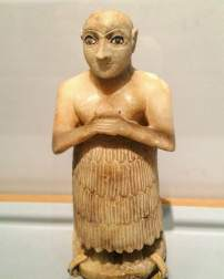 Alabaster statue of a Mesopotamian, apparently in prayer, c. 2500 BC, Penn Museum, Philadelphia