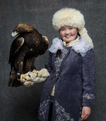 Aisholpan, aged 15, with her eagle at a screening of the finished film