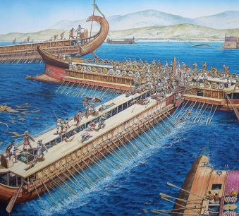A Greek trireme (note the open walkway) rams a trireme from the Persian fleet (note the bulwarks)
