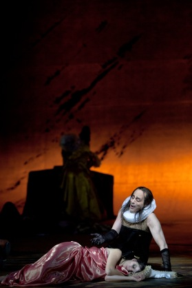 Poppea (here, Anna Prohaska) sleeps, watched over by her nurse Arnalta (Mark Milhofer)