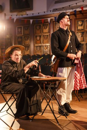 The Sexton (Alfie Webster) and Dogberry (Louis Bernard) interrogate Borachio (Tommy Burgess, unseen)