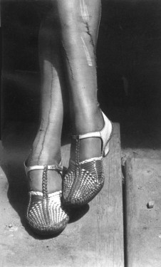 Dorothea Lange, Sign of the Times (Mended Stockings, Stenographer, San Francisco 1934