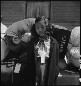 Dorothea Lange, Kimiko Kitagaki guards her family's luggage in Oakland, California, 1942