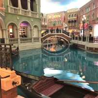 The indoor shopping mall at the Venetian, Macau, is one of the largest in the world, and is arranged around a long, winding reproduction of the Grand Canal. Gondola rides can be taken beneath the permanently blue sky