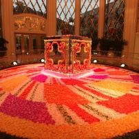 A mirrored cube rotates on a carpet of flowers at the Wynn Palace Hotel, Cotai, Macau